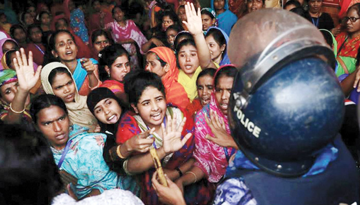 Thousands of workers clash with police over poor pay in Bangladesh
